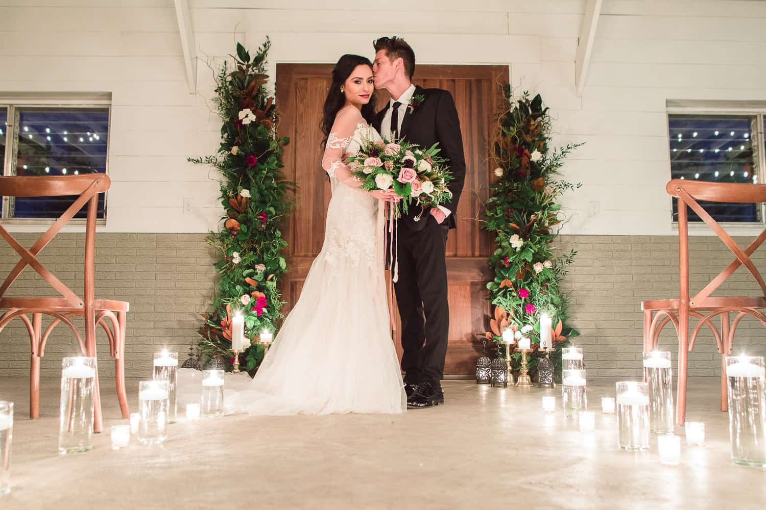 Indoor candlelit wedding ceremony in the winter at Cedar Valley Forest