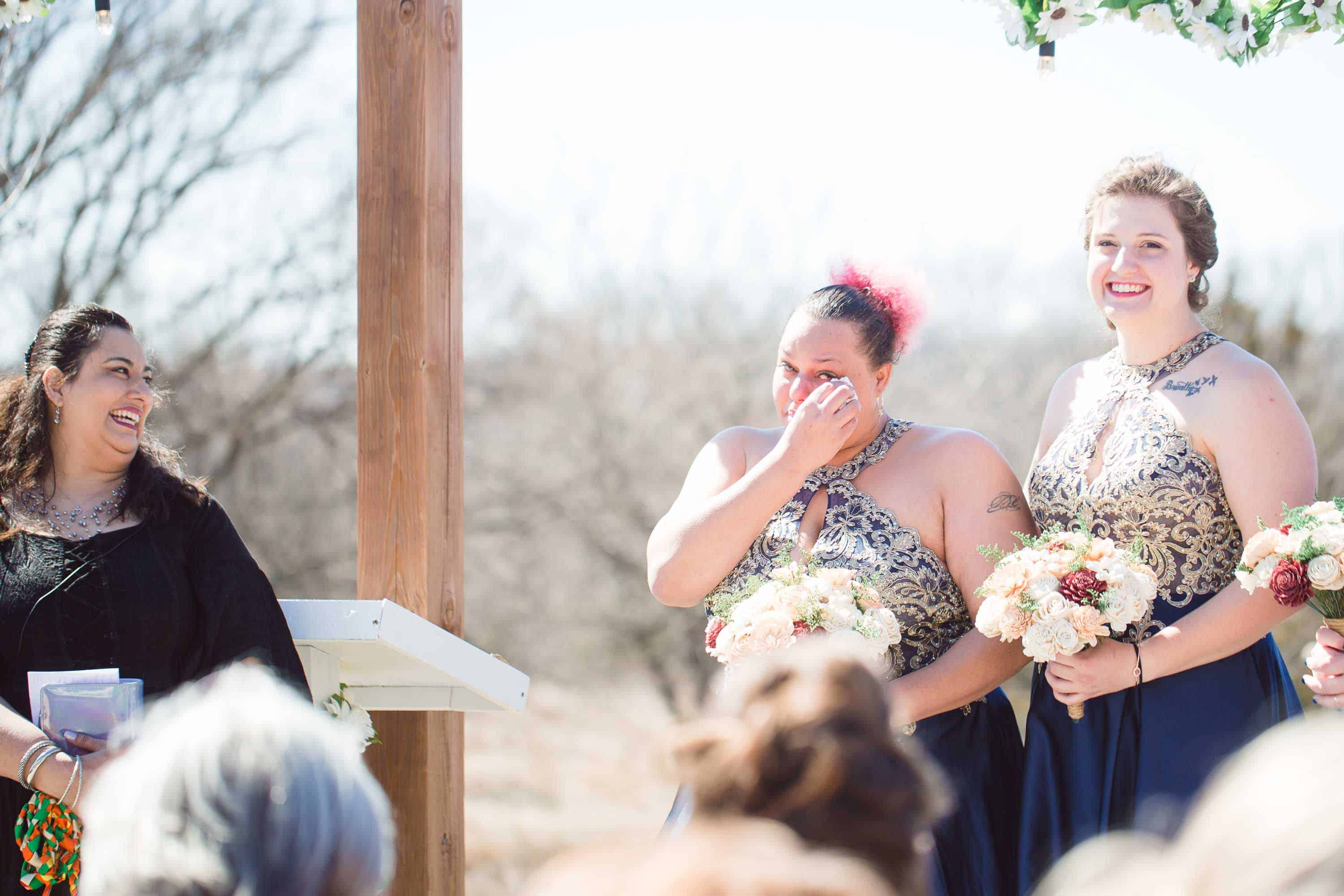 Just the Place barn wedding ceremony in Kansas with emotional groom