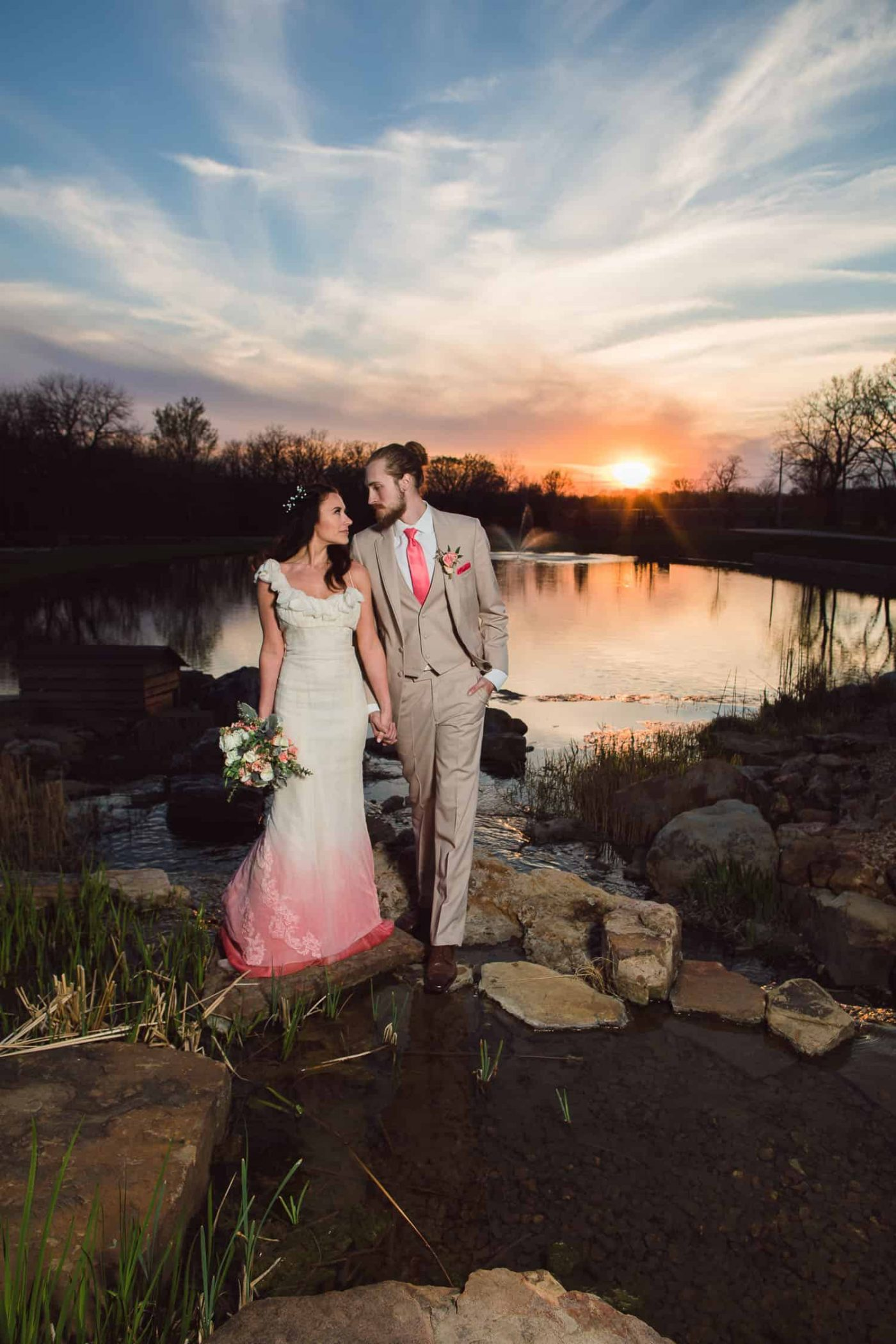 Beautiful sunset after a wedding ceremony at the Bowery wedding venue in Spring Hill Kansas by Kansas City wedding photographer