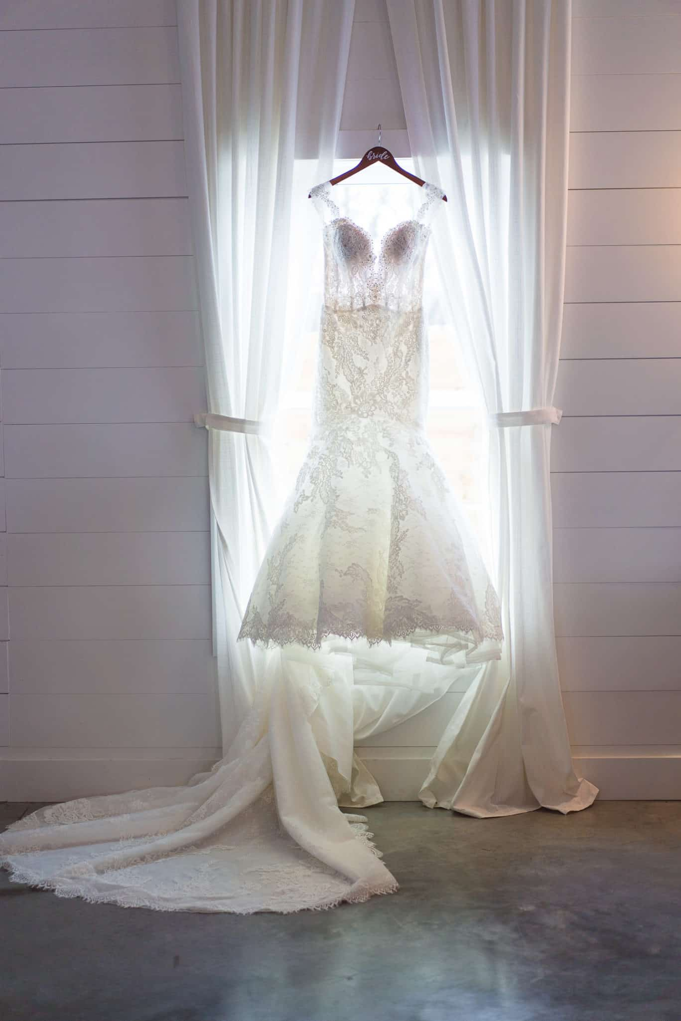 Gown from Bridal Extraordinaire at Mia's bridal provided gorgeous suits for wedding at The Farms at Woodend Springs wedding venue in Bonner Springs Kansas