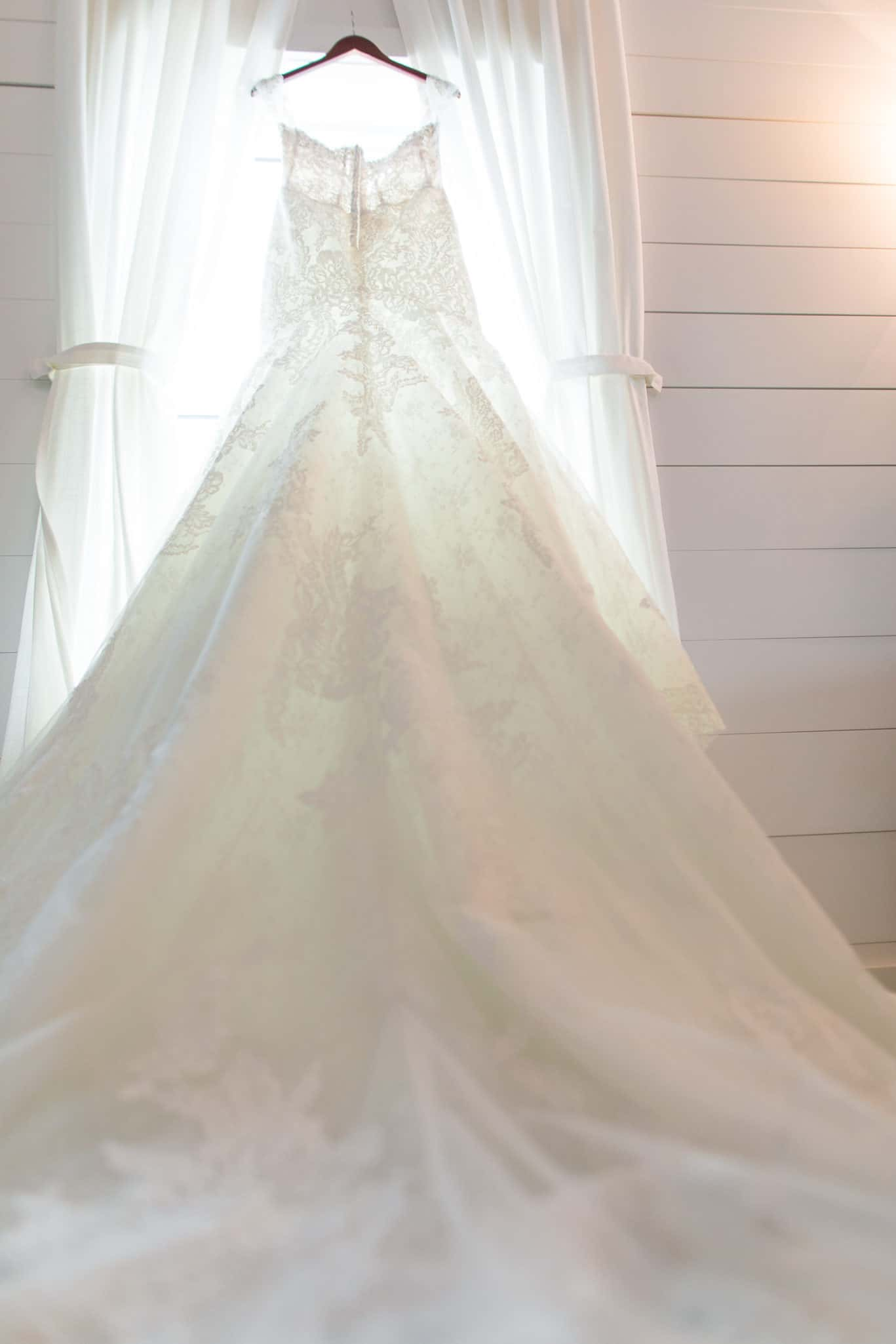 Bridal extraordinaire gown at Mia's bridal provided gorgeous suits for wedding at The Farms at Woodend Springs wedding venue in Bonner Springs Kansas