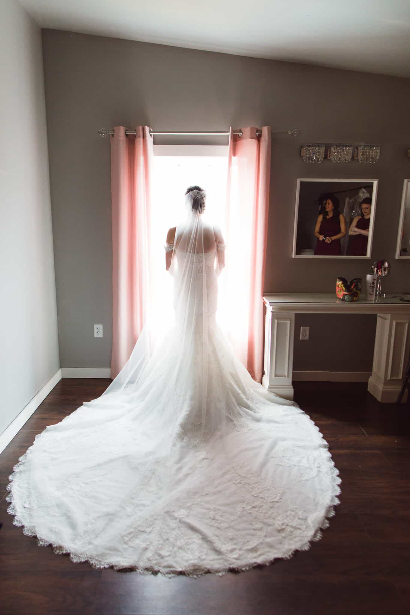 Getting ready in the bridal suite at Mia's bridal provided gorgeous suits for wedding at The Farms at Woodend Springs wedding venue in Bonner Springs Kansas