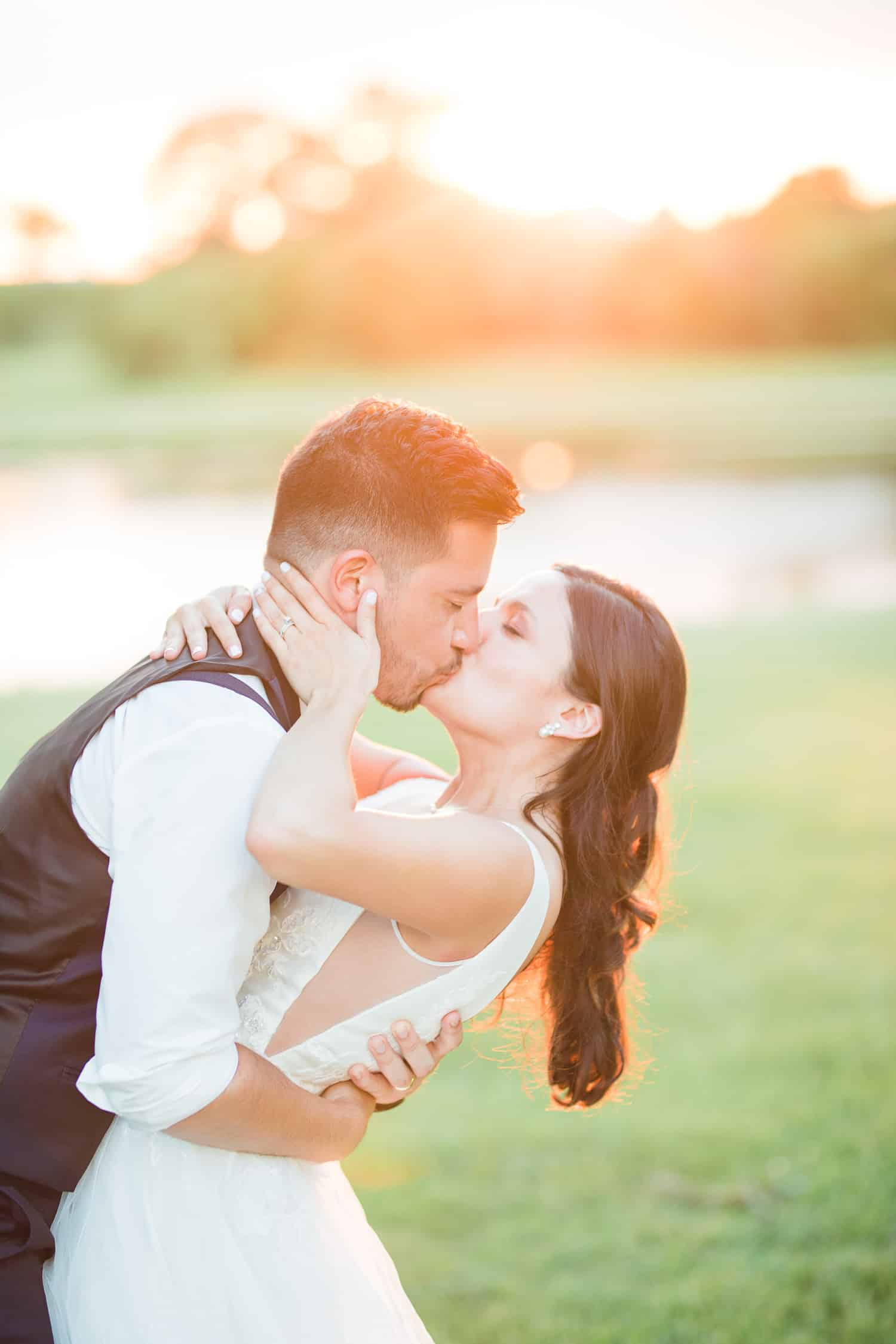 Beautiful sunset image featuring a bride and groom at Cider Hill Family Orchard by Kansas City wedding photographer