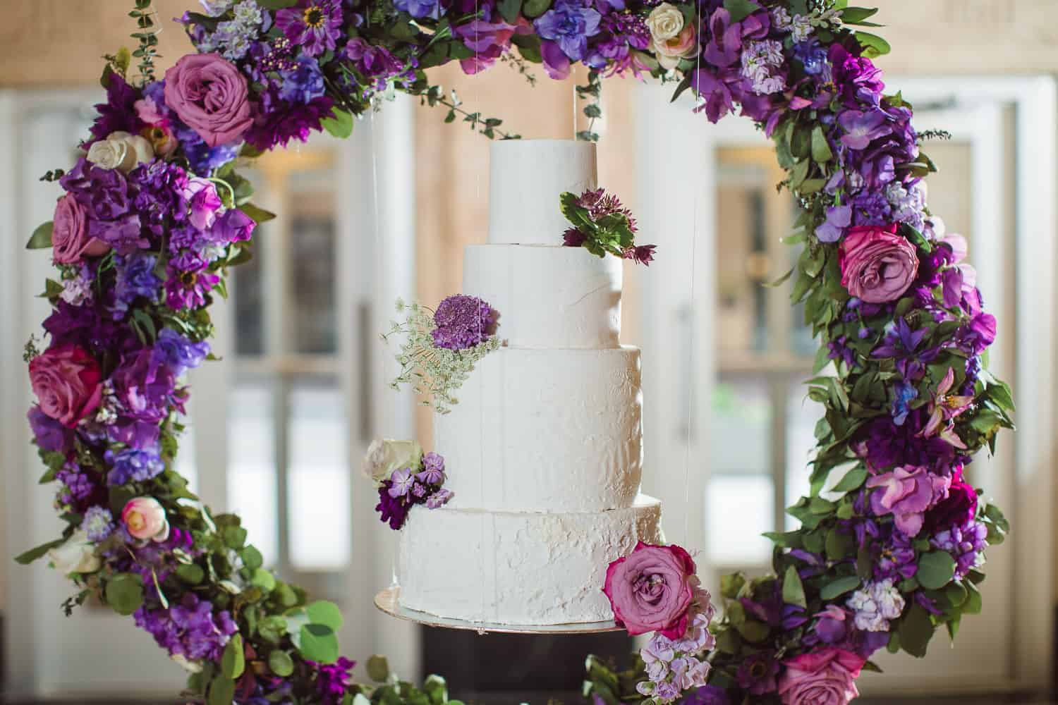 Floating wedding cake by Crumbs and Confections