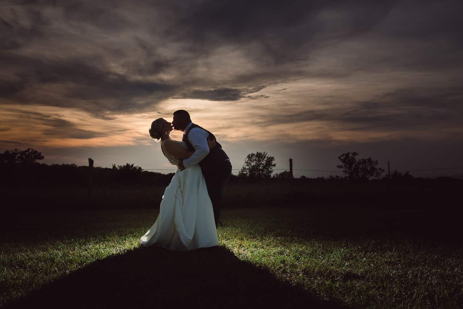 Backlit Bride and groom sunset wedding portraits