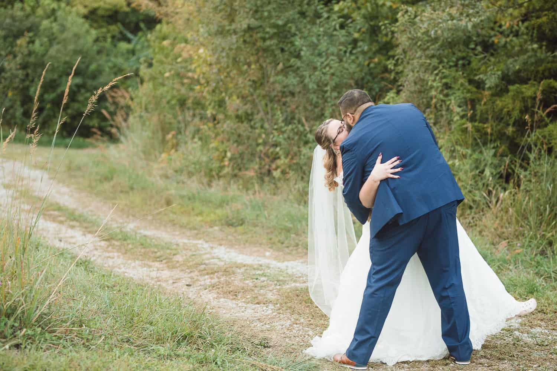 Weston Red Barn farm wedding portraits with bride and groom