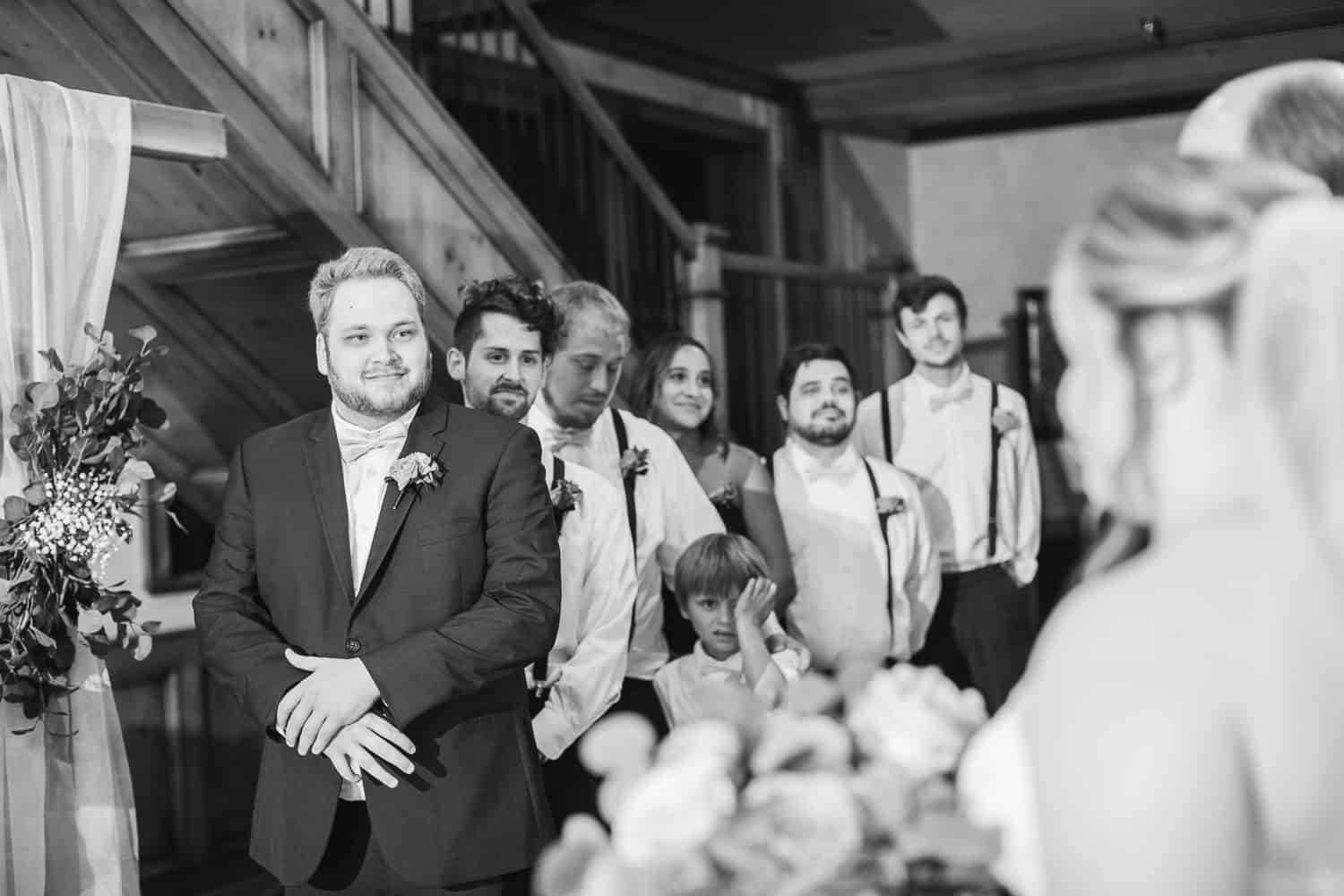 Inside wedding ceremony at the Fire Stables wedding venue in Lenexa