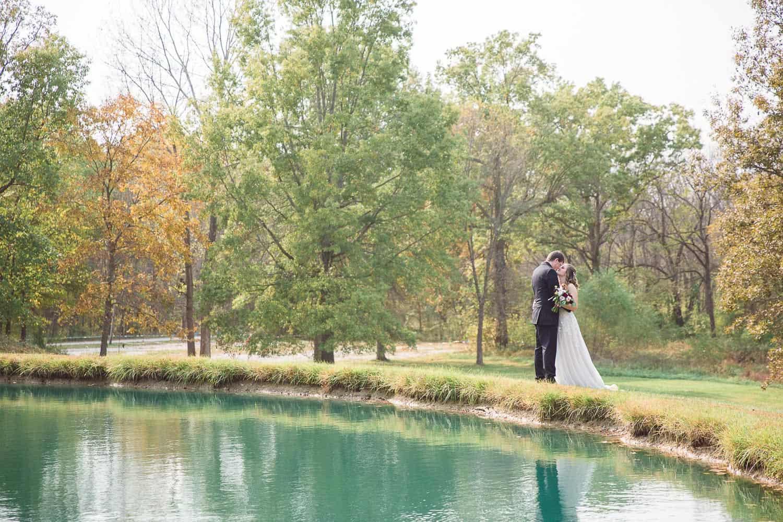 Bride and groom romantic portraits at Enchanted Acres wedding venue Harrisonville