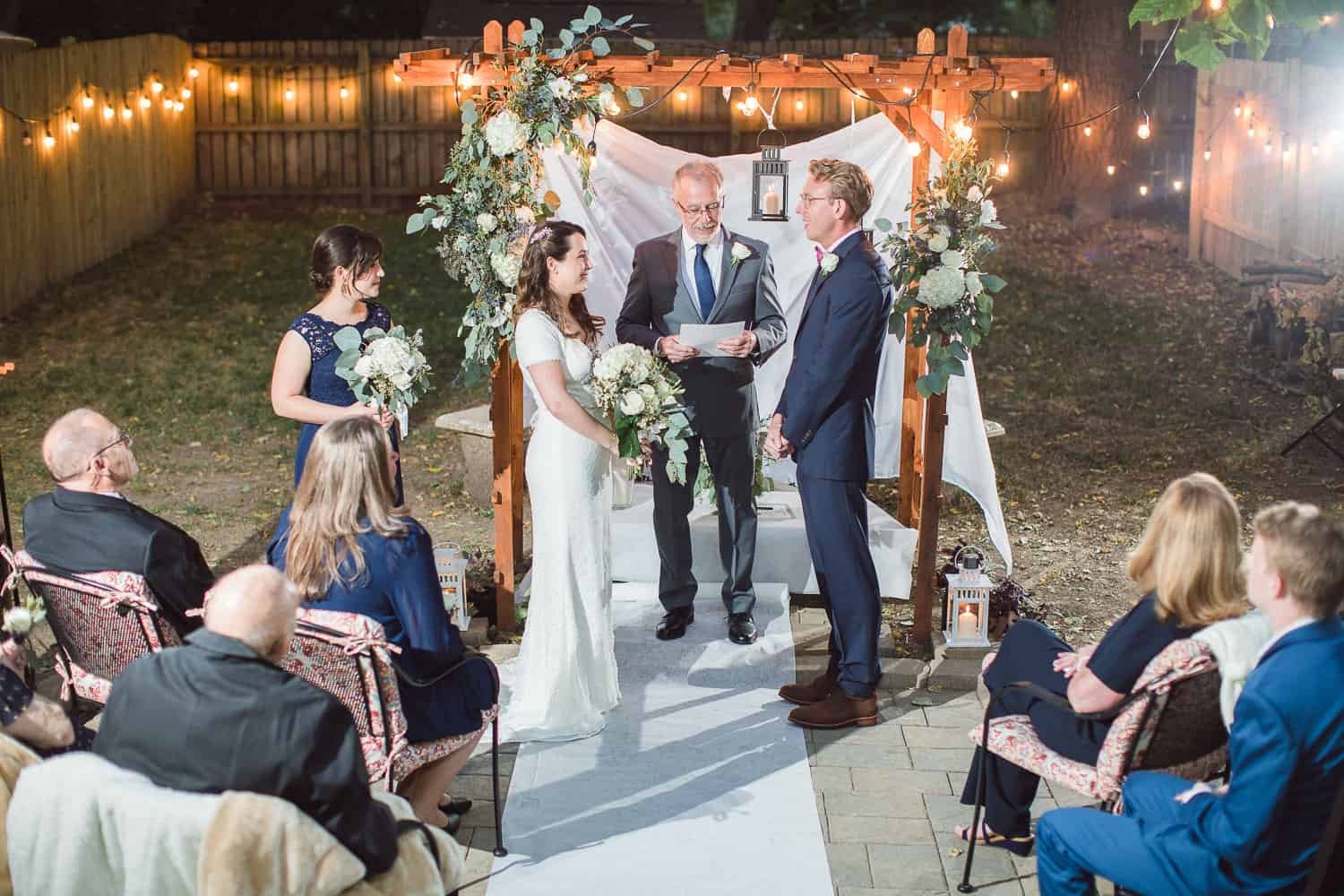 After dark wedding ceremony with twinkly lights