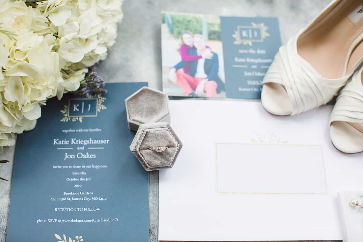 Navy and white wedding invitation and bouquet