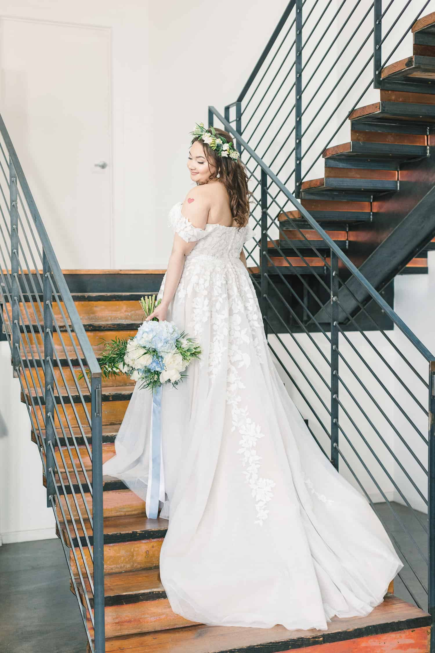 Dress flowing down stairs at the Guild in Kansas City