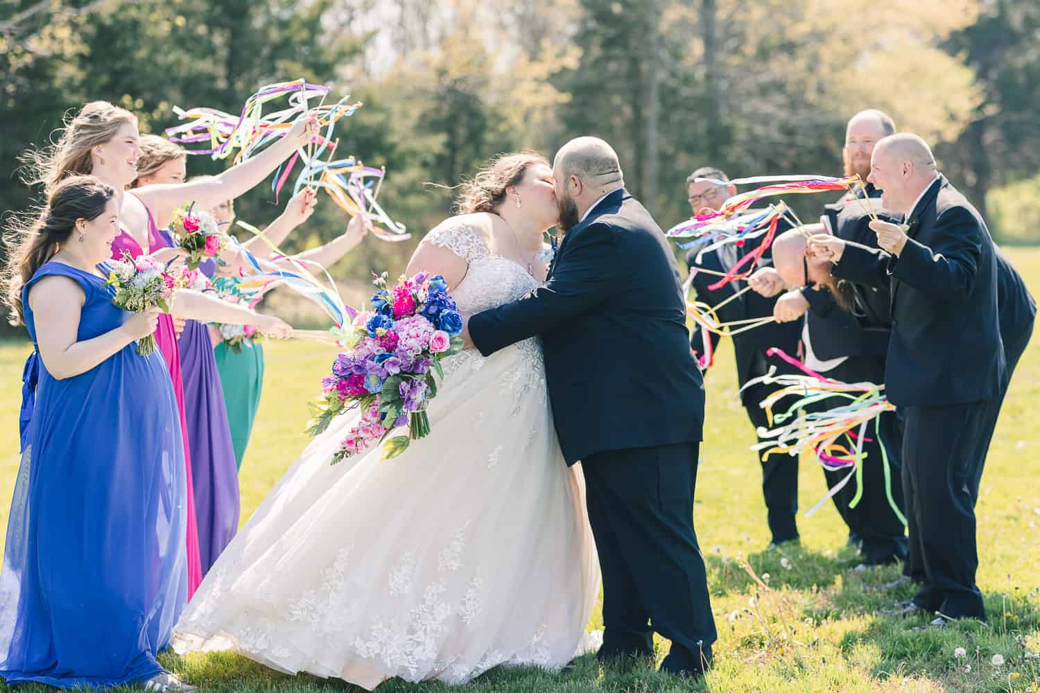 Wedding party photos with streamers