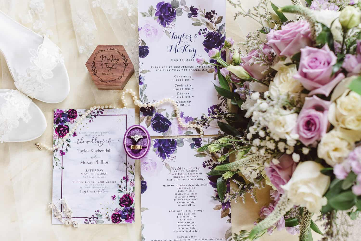 Beautiful details with invitations and rings at Timber Creek Event Center wedding